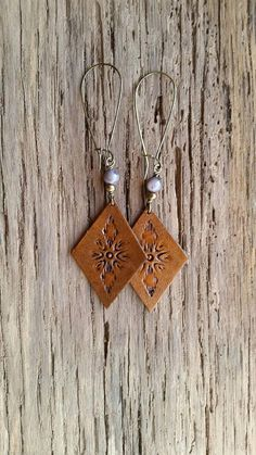 Check out this item in my Etsy shop https://www.etsy.com/listing/559179922/handmade-leather-earrings-diamond