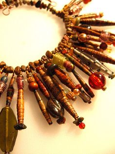 Organic paper bead necklace. Love the different sizes and lengths and embellishments.