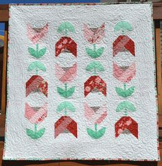 """Today I am so excited to share my newest quilt finish, Dutch Tulips. And I like to call this the """"What Little Girls Are Made Of"""" edition. ..."""