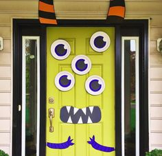 Create a multi-eyed door monster with paper plates.