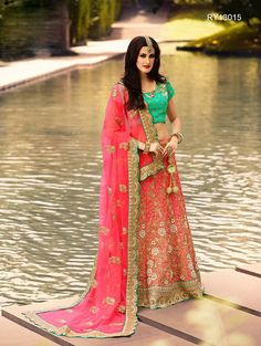 Buy Designer Bridal Lehengas, Wedding Lehengas Online : Showcasing elegance with this pink shaded and green satin unstitched lehenga choli spruced up with intricate zari resham work. Paired with a matching dupatta. It can be customized upto size 42. *Call / Whatsapp / Viber : +91-9052526627 *Email : customercare@natashacouture.com *Worldwide Shipping | Free shipping in India | Cash on delivery *