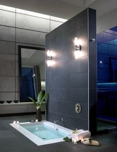 Sleek bathroom with a sunken bathtub.