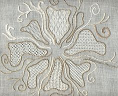curvilinear pulled thread design - motif is pulled stitches