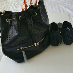"""Black Cut Out Vegan/lead-free Bucket Purse Goes with everything bag!  Brand new with tags. Black with gold accent. Adjust straps to close and a magnetic closure as well. Has a strap on the back to carry as a backpack. Inside has a zipper closure, two open compartments Zipper on the front and back 100%PU, 100% Polyester  Vegan and lead free    Measures 15.5"""" across, 11.5"""" height If you have any questions please ask If you don't like the price please use the offer button ❌Sorry no trades Have…"""