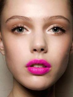the neutral eye balances the bold fuschia lips