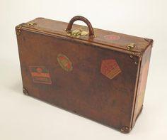 Louis Vuitton Suitcase, c1905. Chestnut Brown Leather Suitcase with travel labels.Lot 64, Bonhams, Paris, 5 February, 2015. Les Grandes Marques du Monde au Grand Palais, Bonhams, Paris, 5 February, 2015.