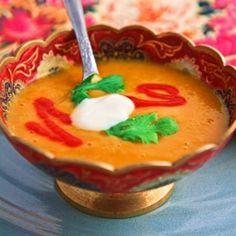 Curried Sweet Potato Soup... [NEED: coconut oil; cayenne; ground cumin; ground coriander; cinnamon; nutmeg; curry powder; onion; garlic; ginger; salt; balsamic vinegar; sweet potatoes; cannelini beans; vegetable broth ; coconut milk ; Siracha Chili Garlic Sauce; limes;  cilantro; Salt and pepper; yogurt] from melomeals.com