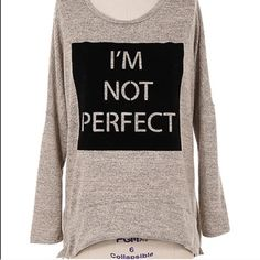 I'm Not Perfect Top Nobody is perfect! In love with this top that isn't afraid to admit it. High low. Brand new with tags! I'm not Perfect design on velvet like puff fabric. Also available in medium and large! Boutique Tops