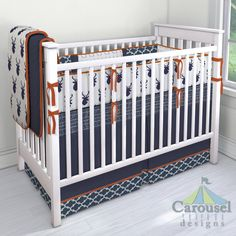 Crib bedding in Silver Gray Antlers, Navy Quatrefoil, Windsor Navy Deer Head, Solid Navy, Solid Rustic Orange, Solid Orange, Navy Herringbone. Created using the Nursery Designer® by Carousel Designs where you mix and match from hundreds of fabrics to create your own unique baby bedding. #carouseldesigns