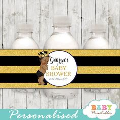 Elegant African American black and gold Prince themed personalized water bottle labels featuring the cutest baby wearing a royal crown against a black and faux gold glitter striped backdrop.