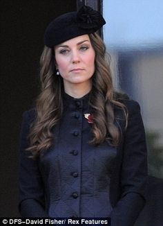 An observant #Kate at the Remembrance parade today 11.10.13 DailyMail