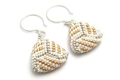 These delicate earrings are bead woven peyote stitch triangle earrings in luster white, gold, and silver. They are made with Japanese delica seed beads in an intricate knot pattern and finished with sterling silver round ear wires. They would be lovely for wedding and bridesmaid earrings.  Approximately 3/4 inch diameter and length. They are light and comfortable to wear.  Free USA shipping and sent in a gift box.  Thanks for looking at my Etsy shop.