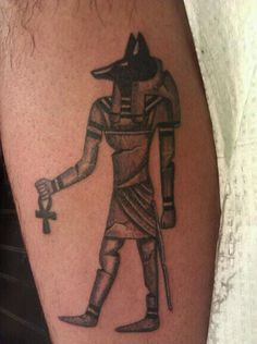 Egyptian God Anubis Tattoo, I wouldn't mind, tying in anubis with Isis and my dogs paw print on the left side.