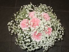 Handtied bouquet of gypsophila with pink carnation inserts