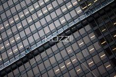 tilt image of illuminated office building. - Low angle tilt shot of illuminated commercial building windows.