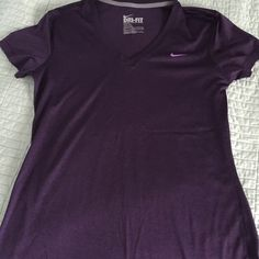 Nike Dri Fit Size Medium Purple Hardly worn- no signs of wear Nike Dri Fit workout top in short sleeve deep purple Tops Tees - Short Sleeve