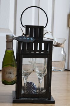 Great Housewarming Gift...Lantern from ikea, small wine glasses and decanter from pier one.