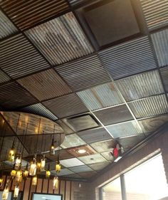 Corrugated metal (ISBU wall remnants) w/ accented by drop-ceiling light fixture.