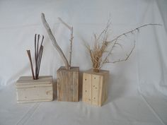 3 pine wood decor blocks made from blocks beneath wooden pallets - drill a hole in these blocks and insert natural items like dried banana tree leaves, driftwood pieces, dry grasses, feathers, candles, or even a little glass tube and water and flowers ...
