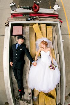 Awesome shot of my couple laying on top of a Fire Truck! from: www.drewnoelphotography.com