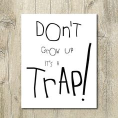 dont grow up its a trap black and white by SunnyRainFactory... i dont think this would be appropriate to hang on my office wall... but I REALLY want to!