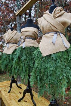 mannequins dressed in cedar and burlap