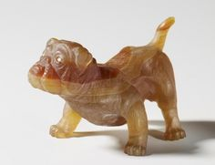 Faberge,  A semi-transparent striated brown agate bulldog with tail raised & legs outspread, with rose diamond eyes. The Royal Collection.