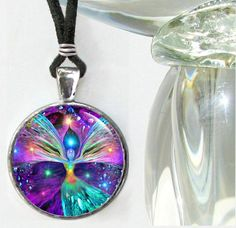 This is a rainbow chakra art angel necklace in my energy line of reiki jewelry. This handmade unique wearable art pendant necklace can be used for its healing energy or as an original fashion statemen