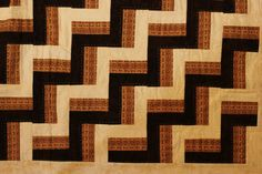 Rail Fence quilt by http://quiltingstories.blogspot.com/2014/11/rail-fence-quilt-brown-beige-white-hand-quilted.html