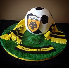 A small AEK soccer ball cake. AEK is a soccer team from Athens, Greece.