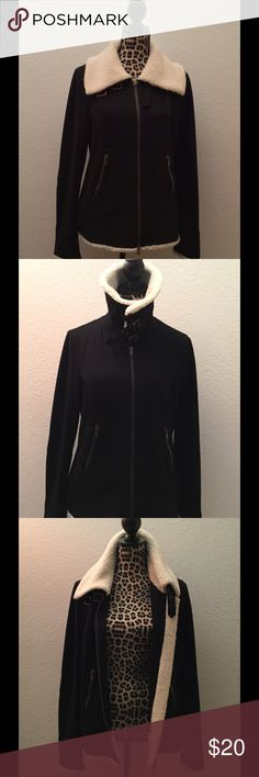 Express Faux Fur Collar Jacket Color: Black with Cream fur. Size: Large (L). Black elbow patches on sleeves. Jacket similar to light-medium weight fleece sweatshirt. Approximate Measurements: Bust: 40 inches, zipped, relaxed. Shoulder: 16 inches. Sleeve: 27 inches. Length: 24 inches. Shell: 59% Cotton, 38% Polyester, 3% Spandex. Collar: 65% Polyester, 35% Acrylic. Express Jackets & Coats