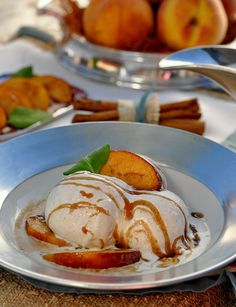 Warm Peaches Foster with Buttermilk Ice Cream More Delicious Desserts, Warm Peaches, Ice Cream Recipes, Beans Buttermilk, Peaches Foster, Peaches Recipe, Everyday Southwest, Vanilla Beans, Buttermilk Ice Peaches Foster with Vanilla Bean Buttermilk Ice Cream Recipe - Everyday Southwest Blog Warm Peaches Foster with Vanilla Bean Buttermilk Ice Cream Recipe