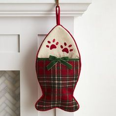 Our adorable fish-shaped stocking is just what you need to give your feline friend a reason to celebrate the season. The classic plaid fabric fits in perfectly with your holiday decor, and the adorable kitty paw prints make it Santa's favorite stocking to fill.