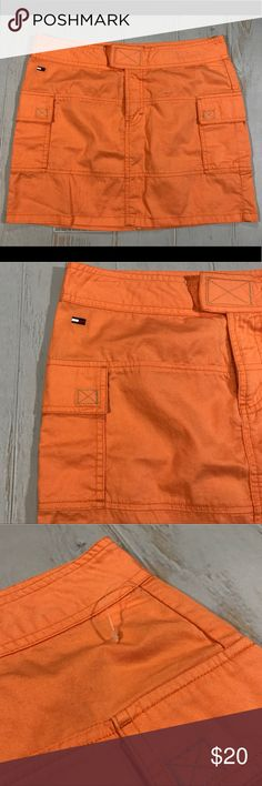 Vintge Tommy Hilfiger Orange Cargo Mini Skirt NWOT Vintage Tommy Jeans Hilfiger Orange Cargo Pocket Mini Skirt   Size 7 (refer to measurements)  New with out tags still has plastics piece but tage fell off!  Waist Laying Flat: 15.5 inches  Bottom Length laying flat: 19 inches  Length: 15 inches  All measurements are taken with items laying flat!  If you have any questions please message me thanks!  Check out my other listings! Tommy Hilfiger Skirts Mini