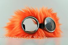 Neon Orange Fluffy Goggles  GENERAL PRODUCT INFO:  * Original creation by StarCrossedRaver  * Super cool Kawaii raver cyber goggles with Neon Orange Fluffy Fur!  ~(faux fur)  * These Neon Orange Fluffy Goggles come with clear lenses!  * HIGH QUALITY metal frames, not cheap painted plastic, you will LOVE these goggles!  * Great for concerts, raves, Burningman, to match your Rave Fluffies, clubs, cyber goth events, Bubblegoth wear, Cosplay, or anywhere you want to look awesome in general…