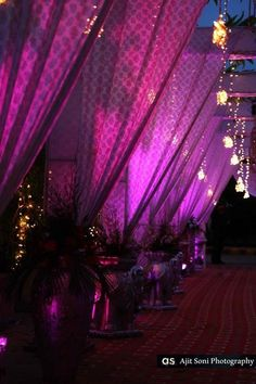 Purple curtain drapes, purple themed entrance, hanging ferry lights