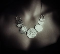Many Moons - Moon phase bib necklace of hammered metal  #handmade #jewelry