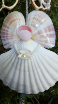 Angel holding a pearl Ornament by SeaThingsVentura on Etsy, $16.50