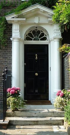 "thefoodogatemyhomework: "" Engaged columns, entablature, huge dentils, classical pediment, fanlight, centered knob on the that gloss black door. classicalbritain: "" Georgian Doorcase "" """