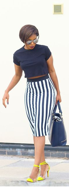 This trend is a nice look for girls that do not have the 6 pack waist but want to show a little midriff. Blue-n-White with a pop of color in the shoes.