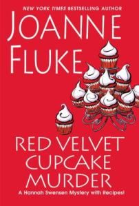 "Red Velvet Cupcake Murder by Joanne Fluke. ""This is the latest book in the Hannah Swensen cozy mystery series, which begins with Chocolate Chip Cookie Murder. They are set in fictional Lake Eden, Minnesota, where Hannah owns The Cookie Jar, a cookie bakery and coffee shop, frequently finds bodies, and tries to decide which boyfriend she likes best: Mike the detective or Norman the dentist."""