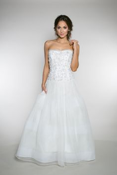 {Laura Snyder} This dropped waist ball gown is a wedding dress that features a box pleated skirt with 3 rows of horsehair sewn into organza. The beaded sweetheart bodice is finished with 3 layers of overlapping organza. | Bride | Wedding | Wedding Dress | Wedding Gown | Engaged | Pretty Wedding | Classic |