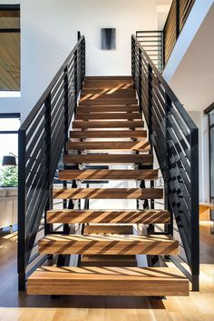 Wood and steel stairs guide you through various levels of this home.