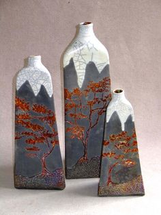 M.Wein. 3 sided Raku bottles White cracle and copper penny glazes fired to 1100c reduced in Eucalipt sawdust.