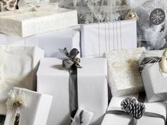 While many styles of white wrapping paper feature patterns, plain white kraft or butcher paper are more simplistic alternatives. To help keep focus on the tree, consider mixing in plain white wrapped gifts dressed up with metallic bows and ribbon.