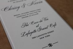 Custom rehearsal dinner invitation on Crane pearl white lettra 220# mounted on antique gray linen. Black letterpress. Manhattan wedding. The Cave du Vin at Lafayette Grand Cafe.