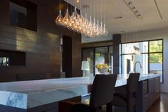 Pendant light, marble countertop, wood walls