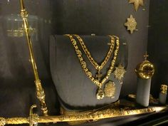 The coronation regalia of the Danish Monarch, which comprises a scepter, sword, orb, diamond star orders, and necklaces.