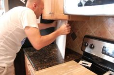 Backsplash makeover: Hot glue bead board over current backsplash. Will stay up for as long as you want, but if you ever want to remove it, it comes off easily.