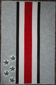 """Ohio State quilt. Anna and I made this for my nephew's OSU graduation. I stipple quilted instead of crosshatch. Also quilted in 3 script """"Ohio""""s since he was in the The Best Damn Band In The Land for 3 years."""